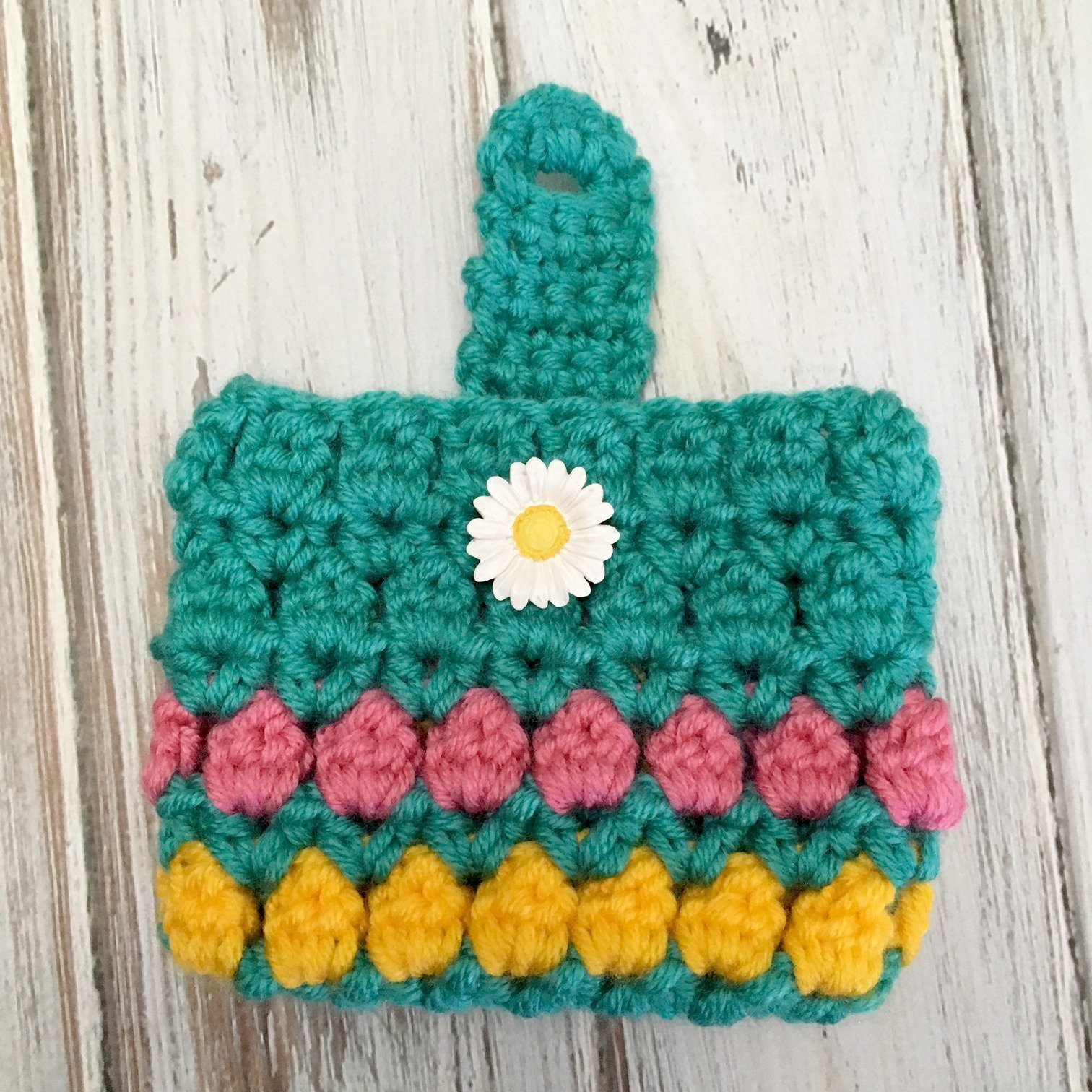 Learn to crochet this quick and easy project with the free pattern for the Summer Fun Coin Purse