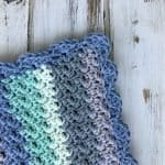This amazing baby blanket is made from only sc and dc! It's so easy and elegant - and a FREE crochet pattern!
