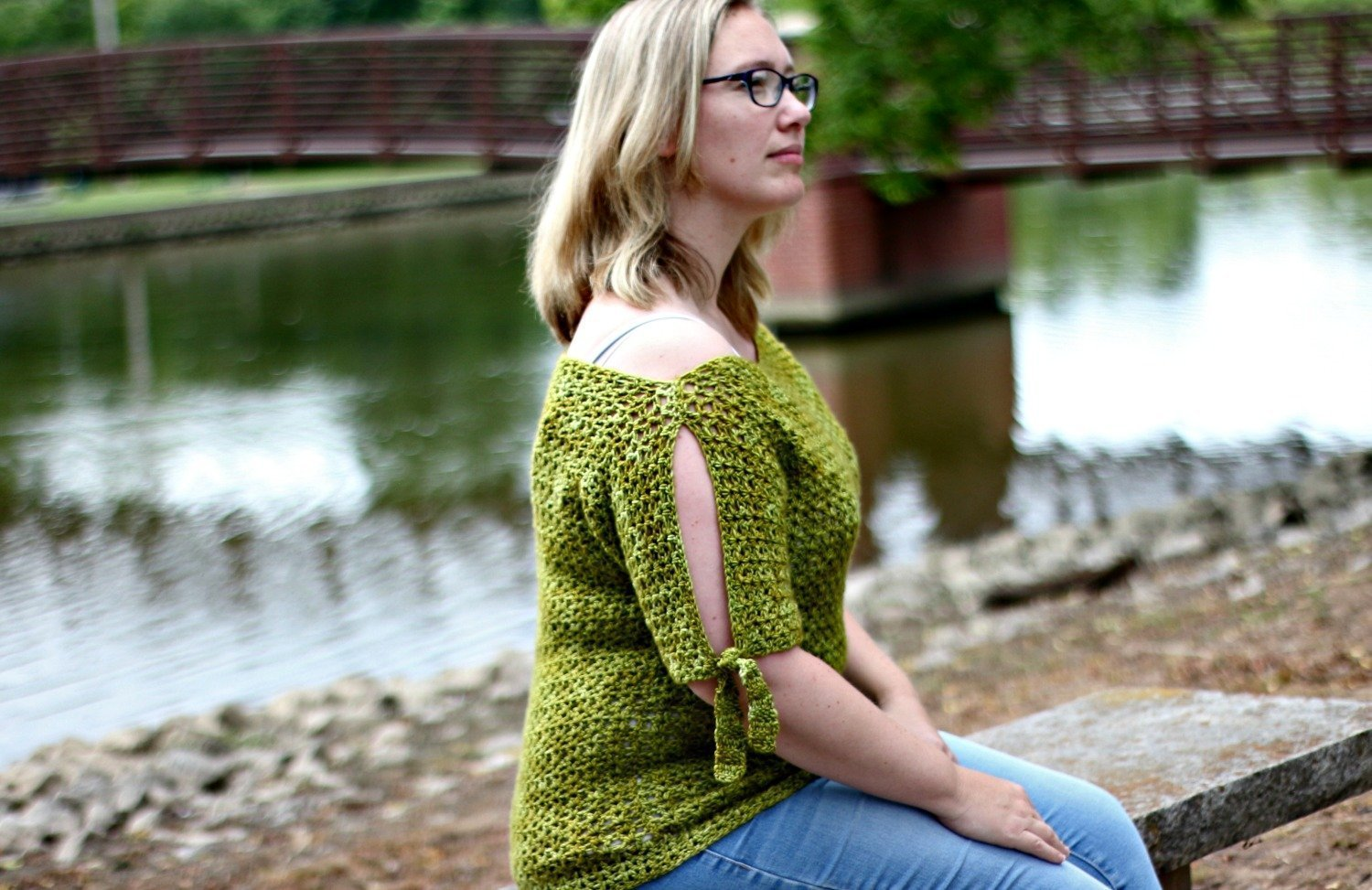 Use this free crochet pattern for the Tie Sleeve Tee to crochet a cold shoulder sweater with tie detailing!