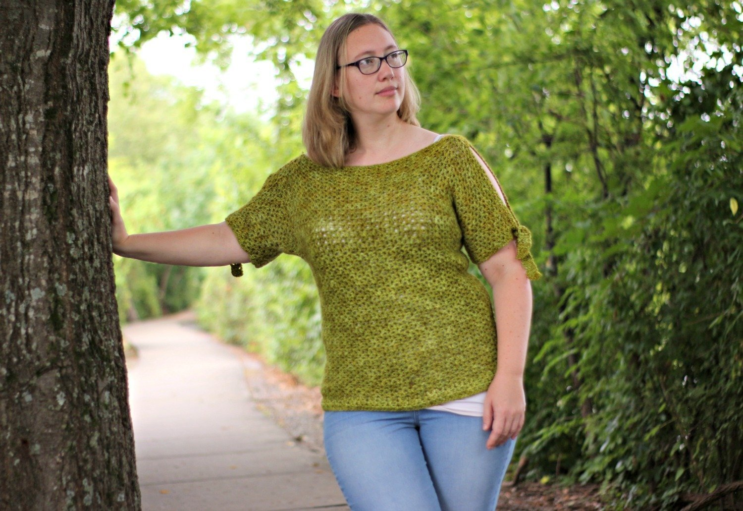 Use this free crochet pattern to crochet the tie sleeve tee - a warm weather top using only dc and chains!