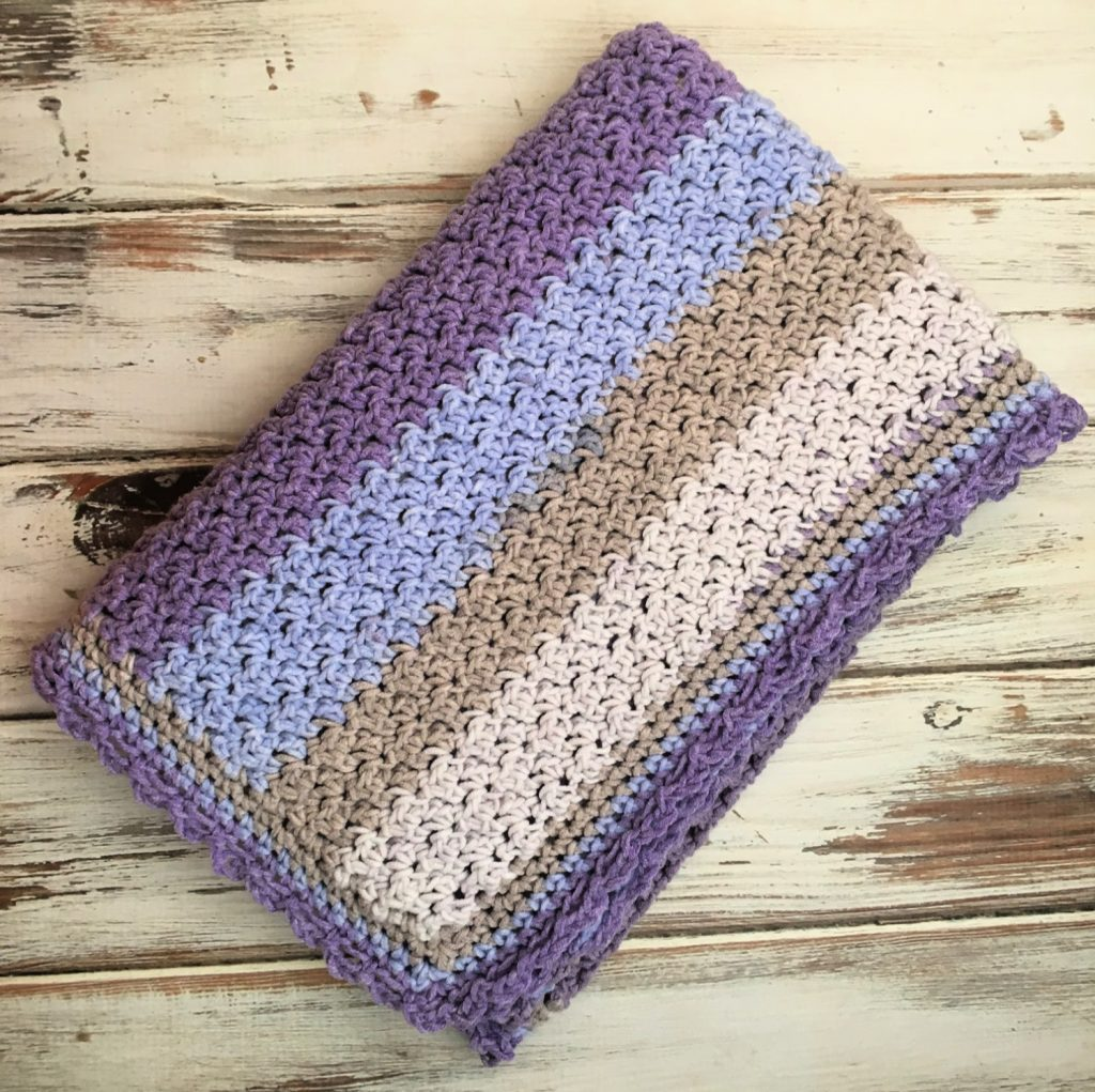 Free crochet pattern!!  The Amethyst Sky Baby Blanket uses only sc and dc and includes a full video tutorial.