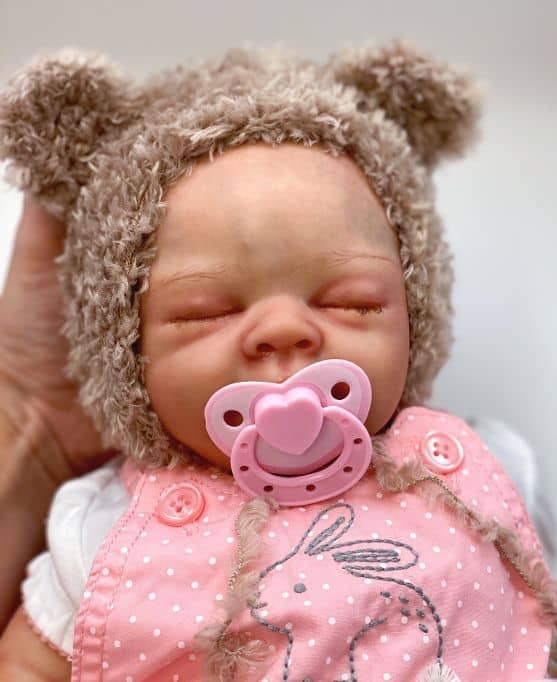 crochet baby hat with sleeping baby