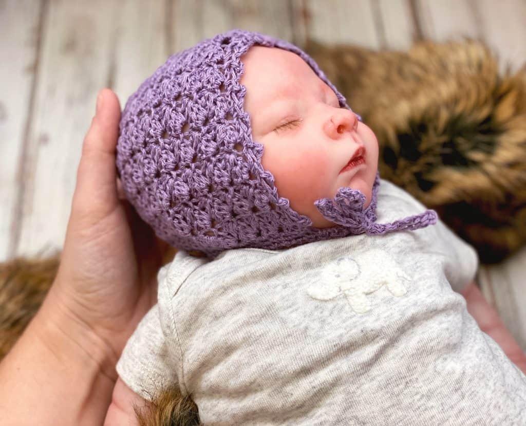 simple crochet baby bonnet side view